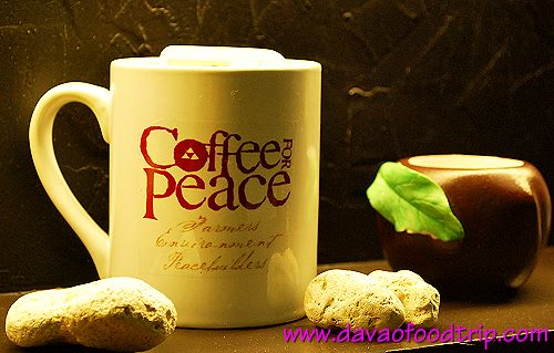 Coffee For Peace (Davao) coffee mug on display
